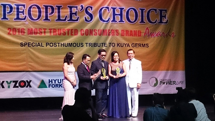 Engrs. Janet and Edgar Loza receiving the Most Trusted Consumers Brand Award and People's Choice Philippines Award